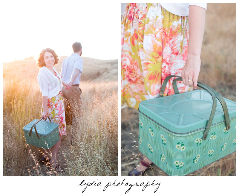 Bride holding a picnic basket while groom is pulling her at lifestyle engagement portraits in the Bay Area of California