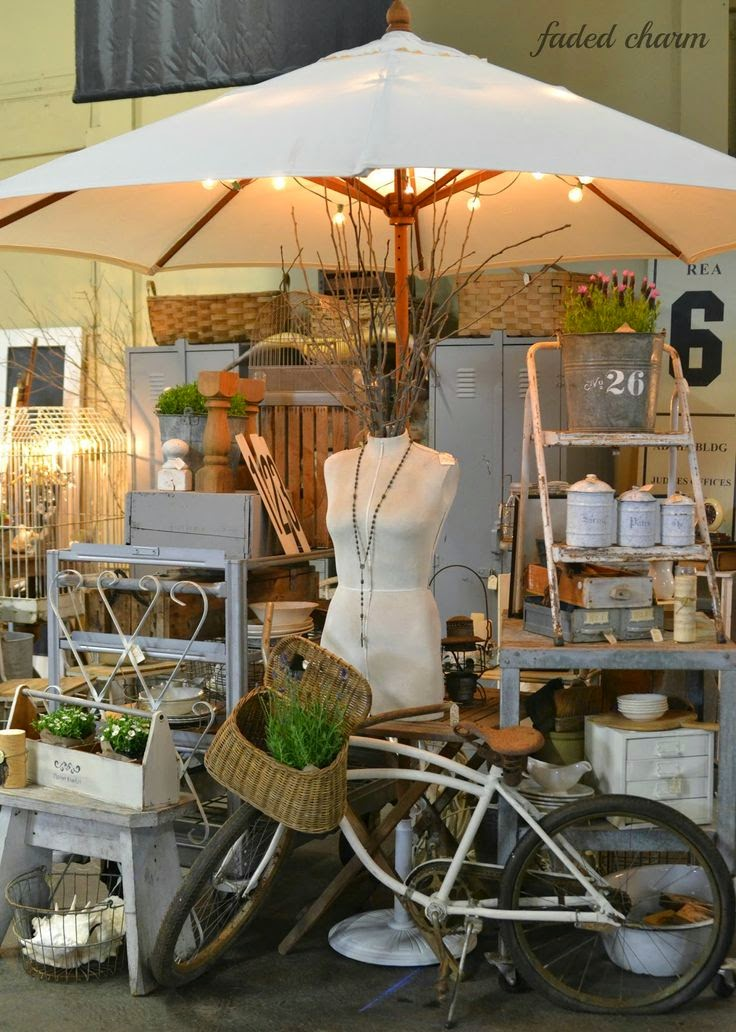 Vintage show off umbrellas as booth decor for Decor vendors