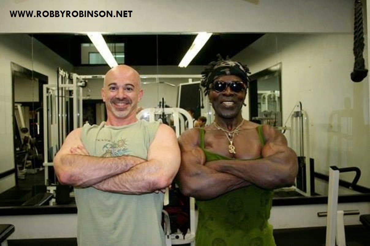 """Gary Casaccio and Robby Robinson - Weider-Bust-Pose - Read about RR's training and life experience, about other legends of Golden Era of bodybuilding and what really happened behind the scenes of Weider's empire - in RR's BOOK """"The BLACK PRINCE; My Life in Bodybuilding: Muscle vs. Hustle"""" ● www.robbyrobinson.net/books.php ●"""