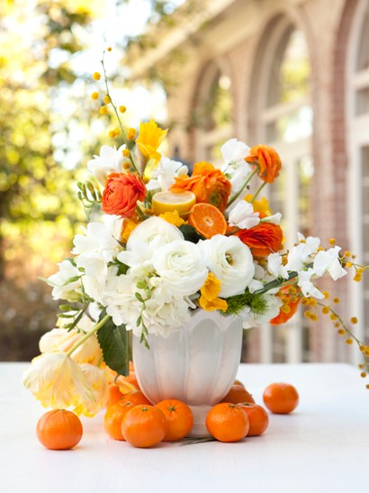 Floral arrangements incorporating fruits and vegetables Floral arrangements with fruit