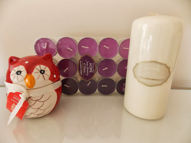 A hand painted owl candle, tea lights and a pillar candle