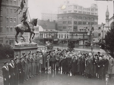 Ceremony by the Joan of Arc statue outside the Melbourne Public library on 14 July 1944