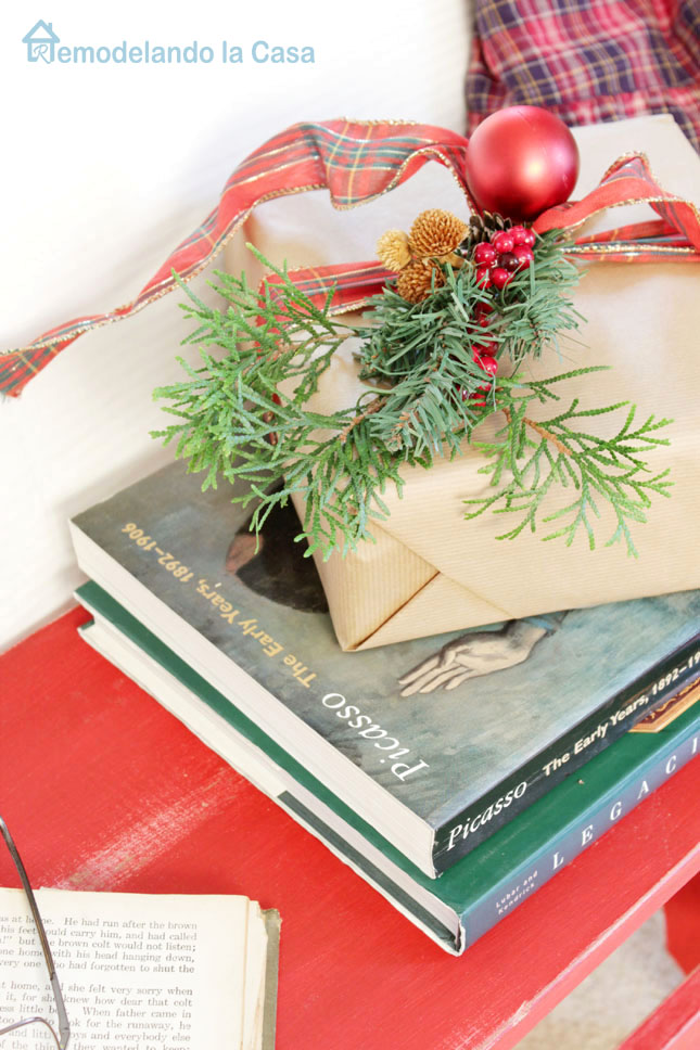 Christmas in the bedroom with books on bench and present