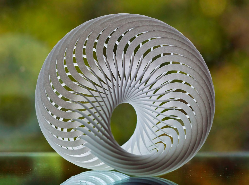 NAUTILUS SHELL MADE OF 36 MOEBIUS STRIPS by JOAN BALDWIN