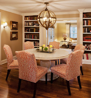 Wonderful Details in the Dining Room with Round Dining Tables and Artistic Chairs under the Rounded Chandelier