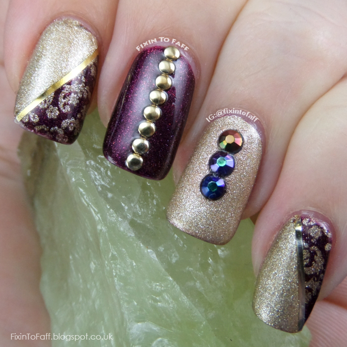An elegant gold and purple nail art look.