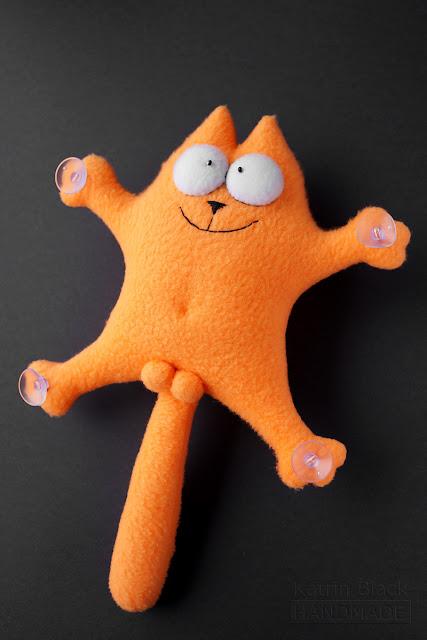 Рыжий кот Саймон - игрушка в машину.