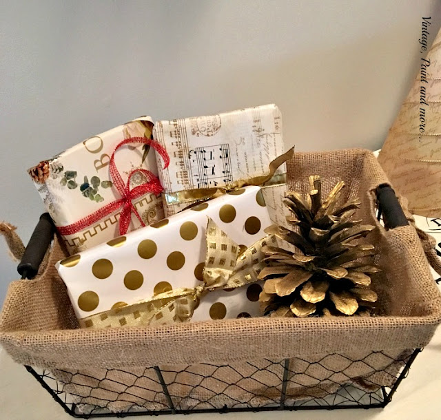 vintage wire basket with burlap liner and faux packages