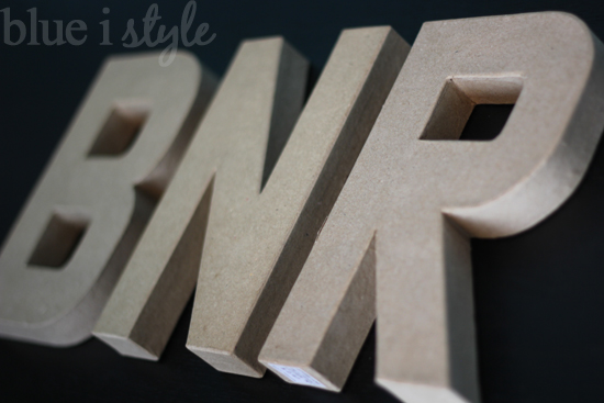 the restoration hardware letters are made of solid wood so to achieve a similar look with my paper mache letters i picked up a couple of sheets of