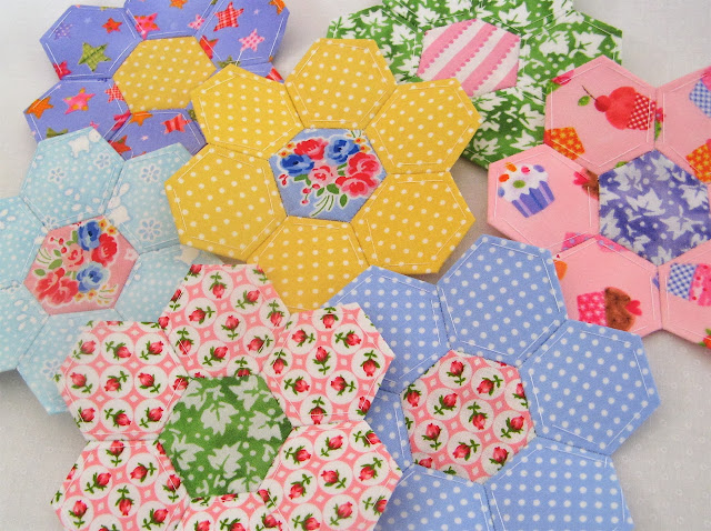 Hand pieced fabric hexagon quilt