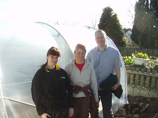 Putting a polytunnel up on World Naked Gardening Day