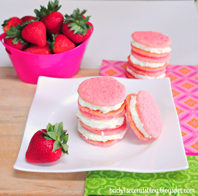 Strawberry Lemonade Cookies http://backforseconds.com #whoopiepie #cookiesandwich #frosting #lemonade #pink #strawberry