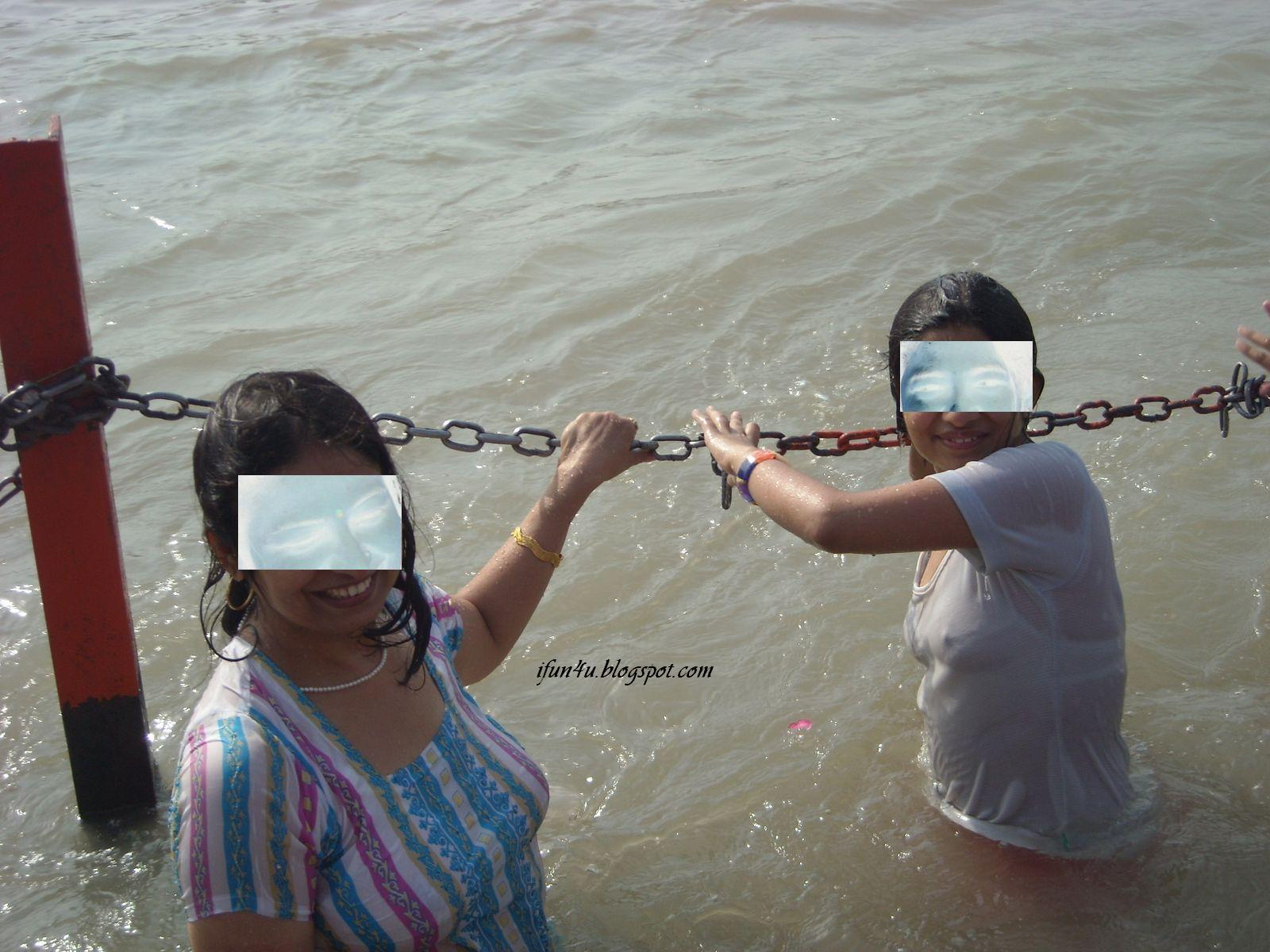 indian girls wife bathing at ganga river