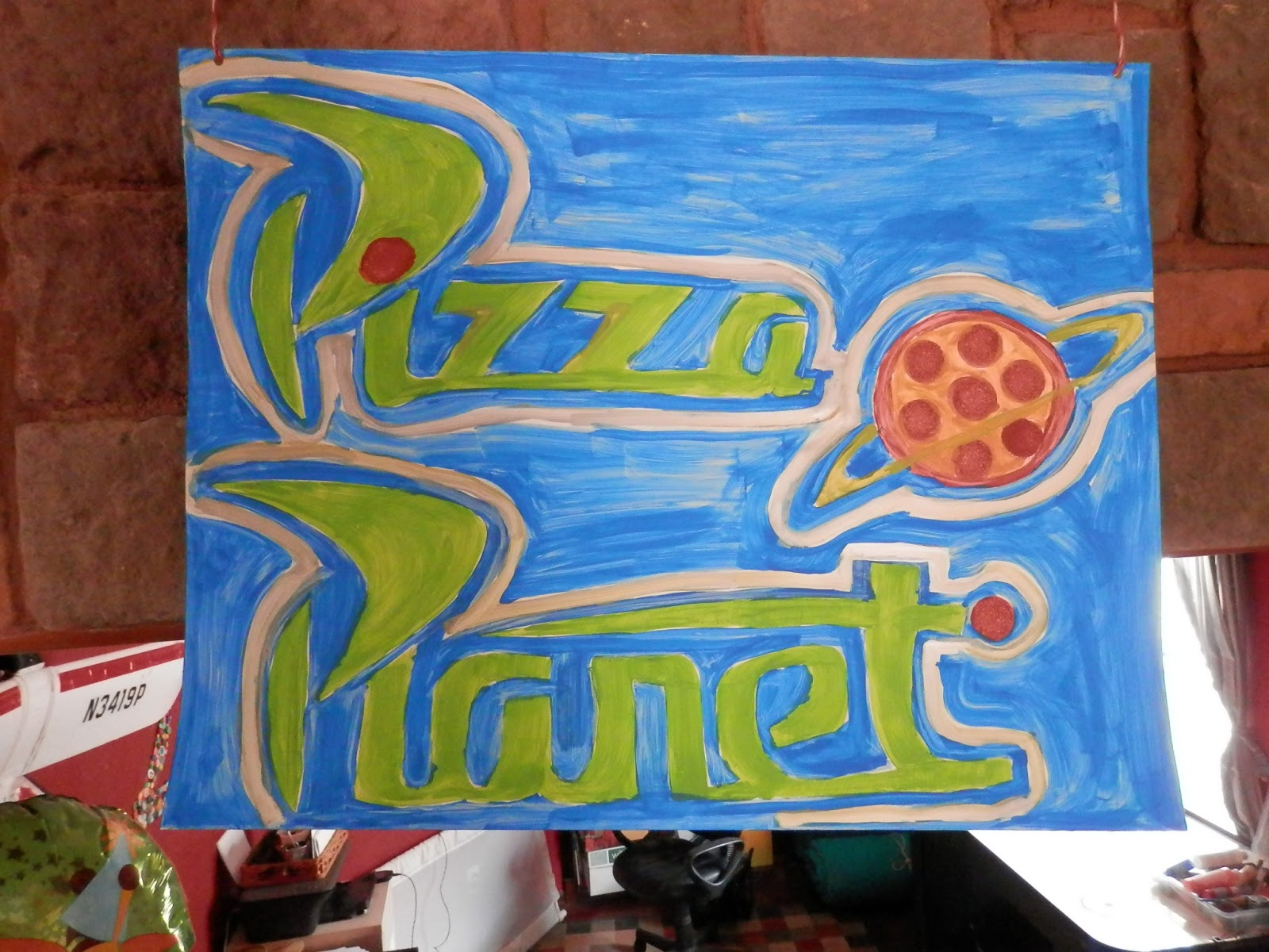 Pizza Planet Sign recreated by Monica Jamer