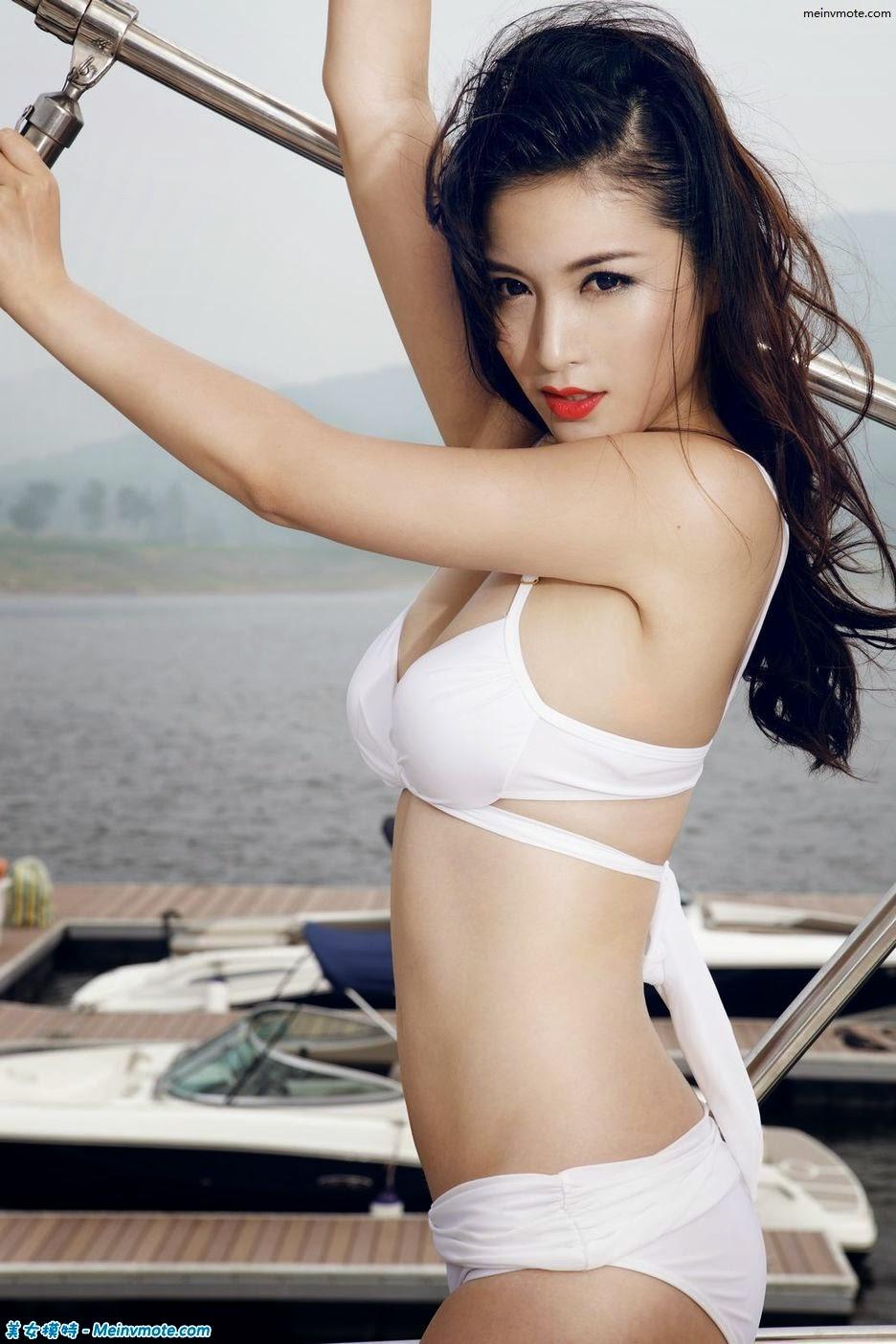 Hot uninhibited female figure on a yacht