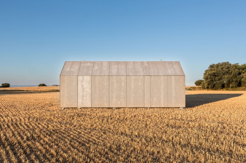 Closed portable home in a field