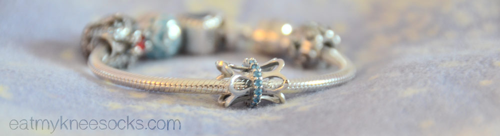 Soufeel's floral basket charm is made from 925 sterling silver with blue rhinestones.