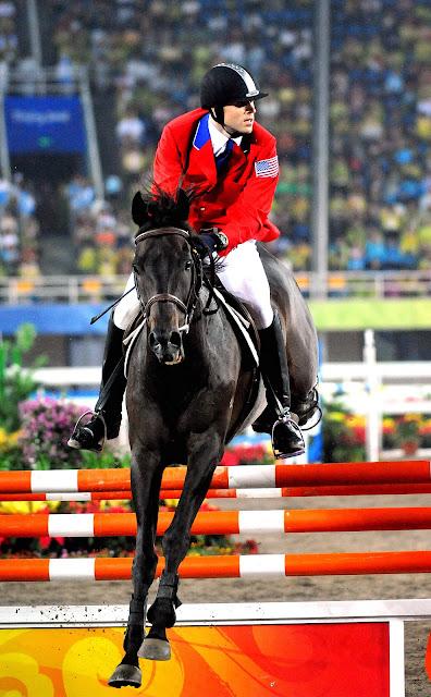 Boy on Beautiful Black Horse Jumping High PictureBlack Horse Jumping