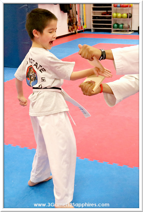 7 year old taekwondo student breaking boards with speed break #GetGoing