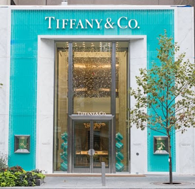 Tiffany & Co. Tiffany & Co. is a holding company, which through its subsidiaries, engages in manufacture and sale of jewelry merchandise. The firm also sells timepieces, leather goods, sterling.