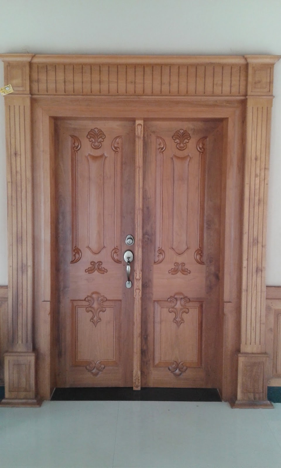 Kerala style carpenter works and designs for French main door designs