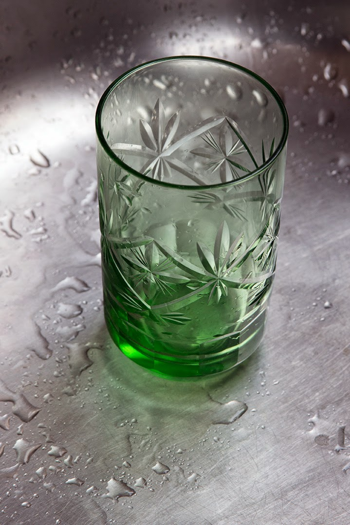 green glass in sink