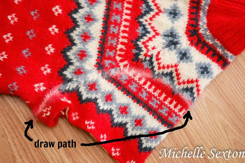 Draw a path to make the arm cutouts - how to upcycle a sweater