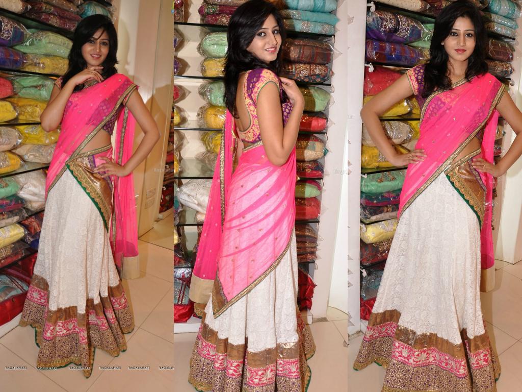 Model Shamili displaying half saree at Mebaz showroom. White color ...