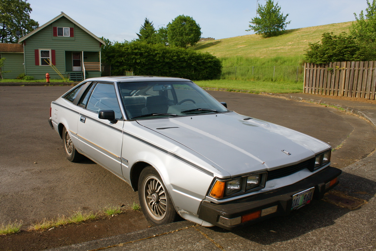 OLD PARKED CARS.: 1980 Datsun 200SX.