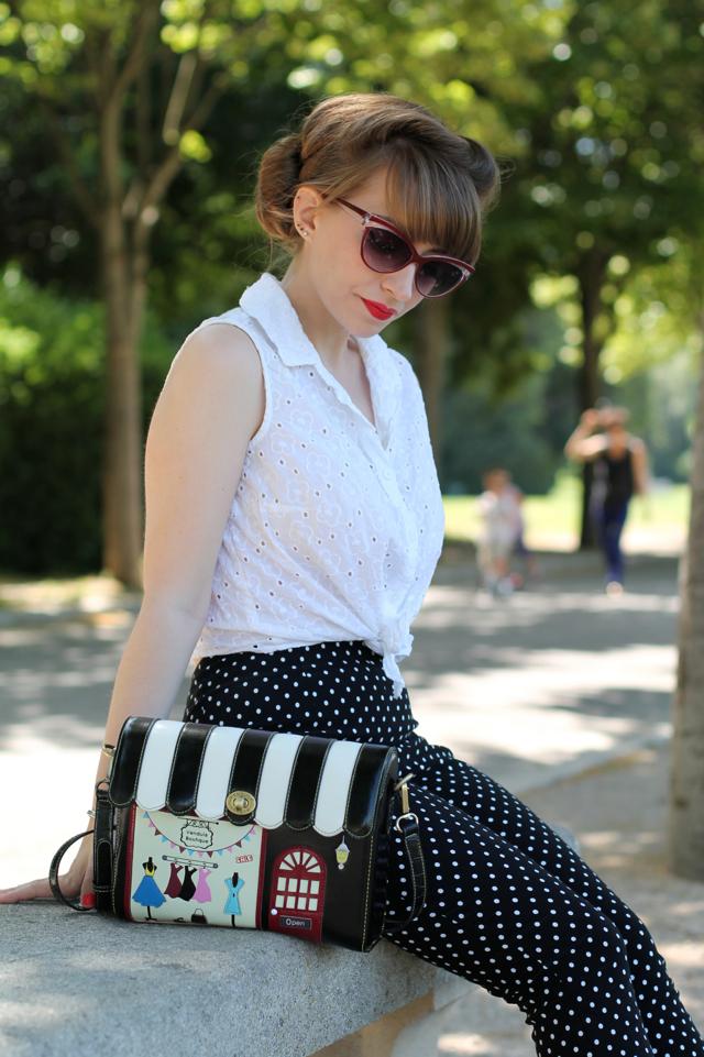 Collectif Judy sunglasses, white tie shirt, polka dot capris and Vendula London bag