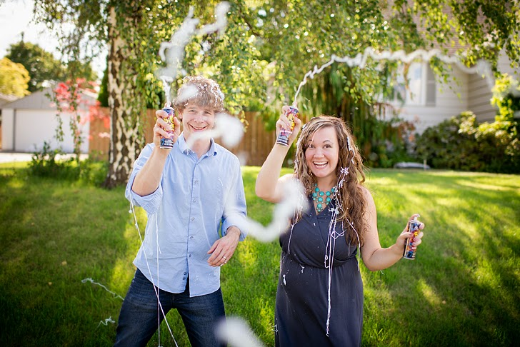 pregnancy gender reveal photo shoot for boy with silly string