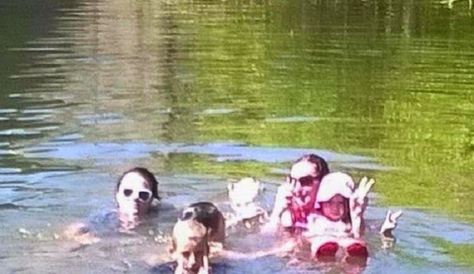 100-Year-Old Ghost Photobombs Family Swimming