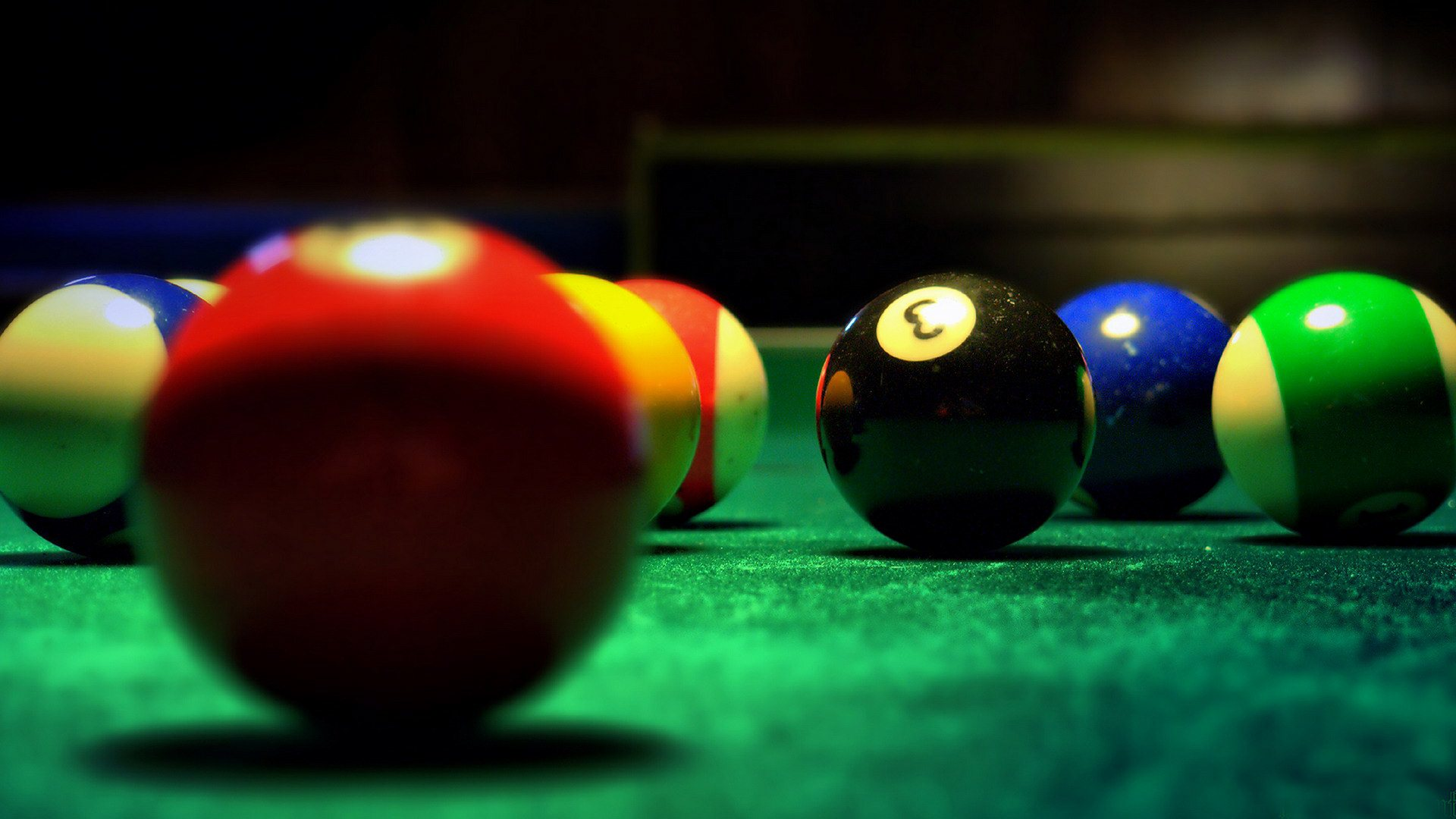 close up of playing a game of pool
