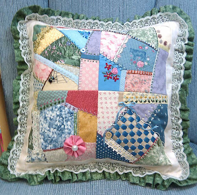 Completed crazy quilt pillow
