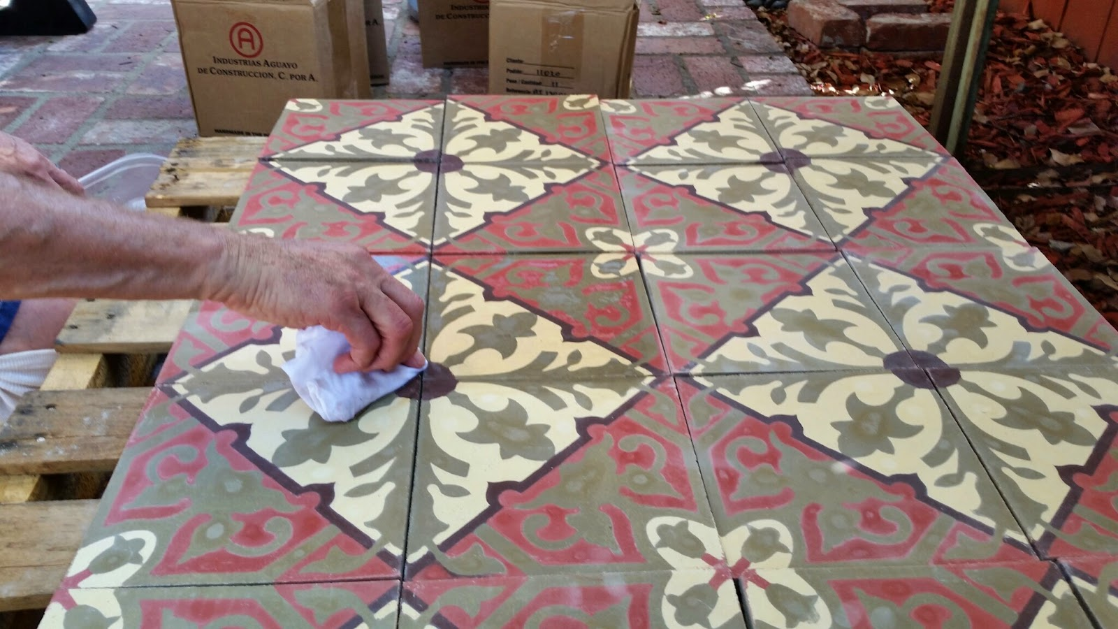 Pre-sealer being applied to cement tile