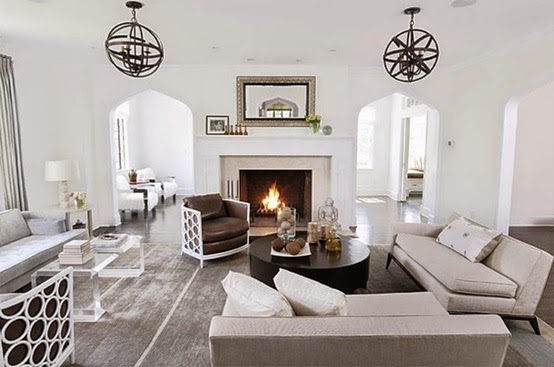 beautiful light bright traditional style white living room with fretwork chairs