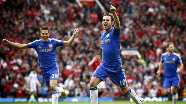 Juan Mata celebrates scoring the only goal at Old Trafford in a crucial game as Chelsea went on to secure Champions League football