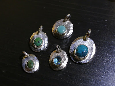 legend silver pendant with different stones