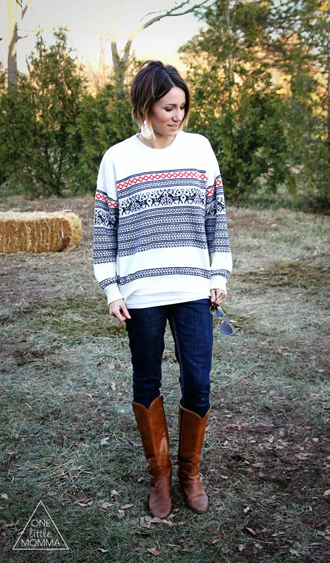 Vintage reindeer sweater, dark skinny jeans, and tall boots