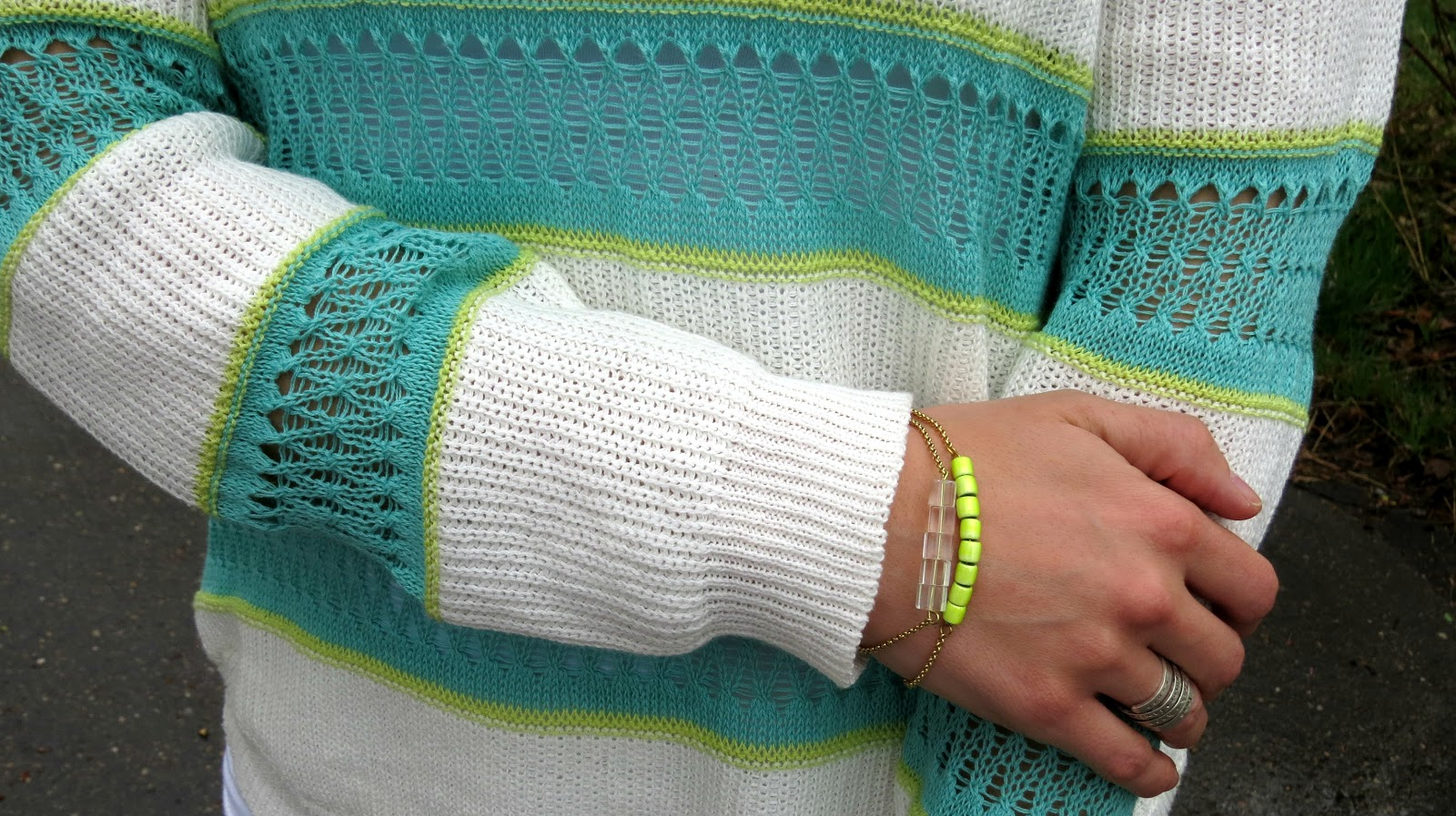 striped mint sweater and neon bracelets