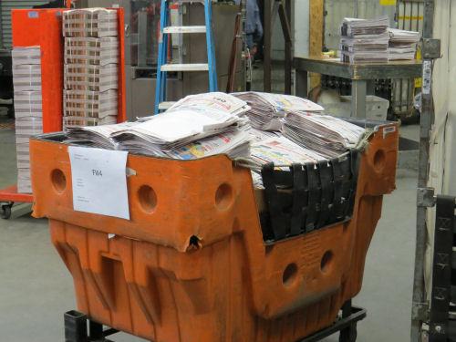 cart of newspaper bundles