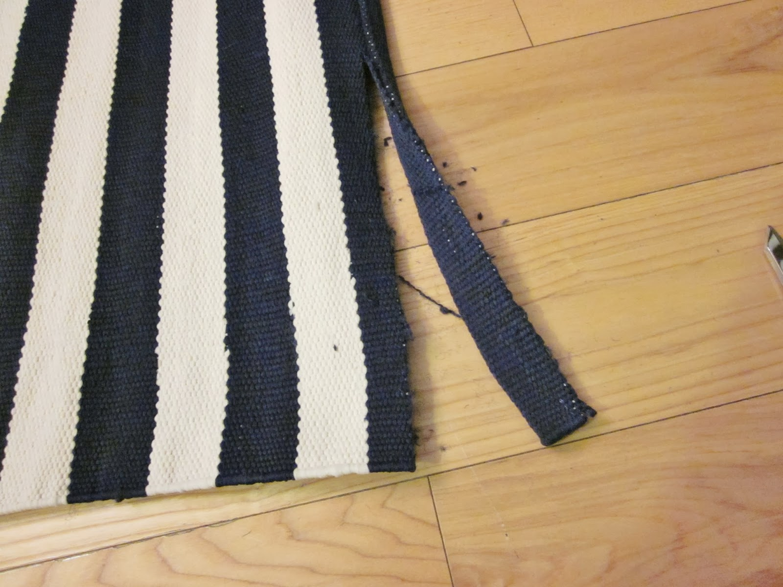 Then I Cut Off Enough So That Had Two Inches On The Rug Past Where Pinned It This Extra Length Gets Folded Over Twice To Prevent Fraying And Sewn