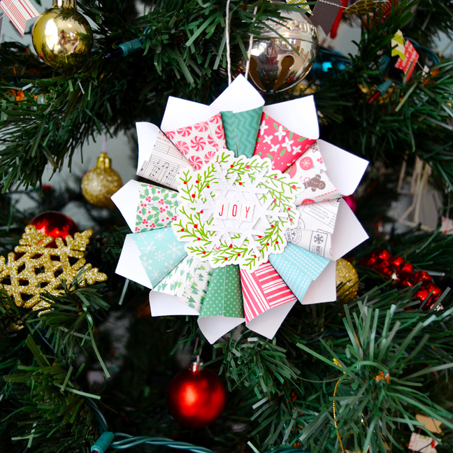 paper ornament made from 12 paper cones stuck in circle with die cut embellishment