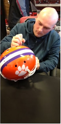 Connor Shaw signs This is out state! on Clemson Helmet.