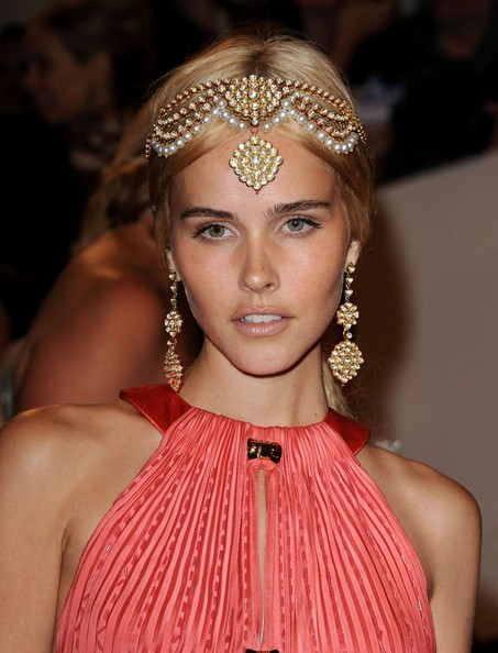 Isabel Lucas looking like a Greek goddess in a coral pleated Louis Vuitton halter gown and intricate gold headpiece and stunning coordinating earrings at the 2011 MET Gala.