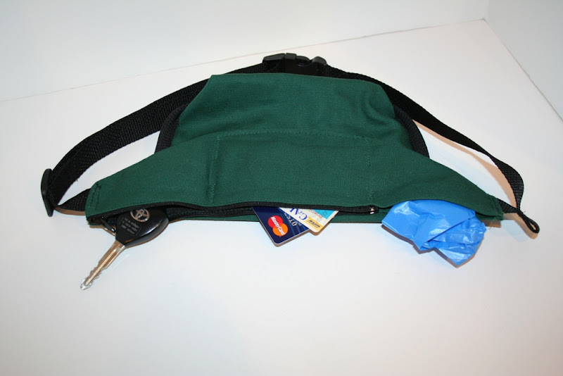 back panel pouches showing keys, credit cards and ID, and poop bag