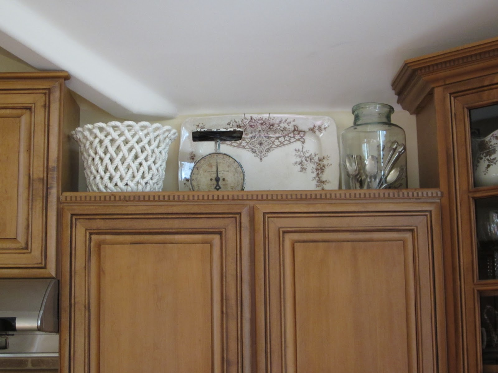 Antiquechase decorating above kitchen cabinets why is for Above cupboard decoration