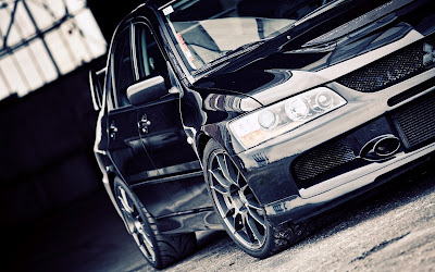 Black Mitsubishi Evolution in Garage HD Car Wallpaper