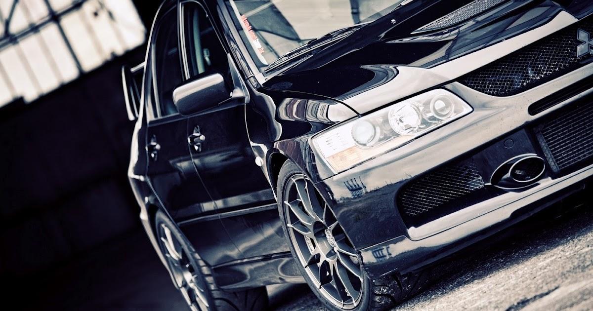 Black mitsubishi evolution in garage hd car wallpapers for Garage auto evo milizac