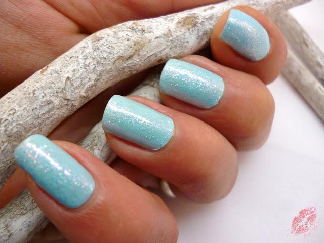 http://tiamels.blogspot.de/2013/12/nails-star-dust-top-coat-753-von-misslyn.html